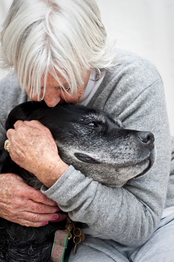 Pet End of Life Care in Lewisville: Old Woman Hugging Old Dog